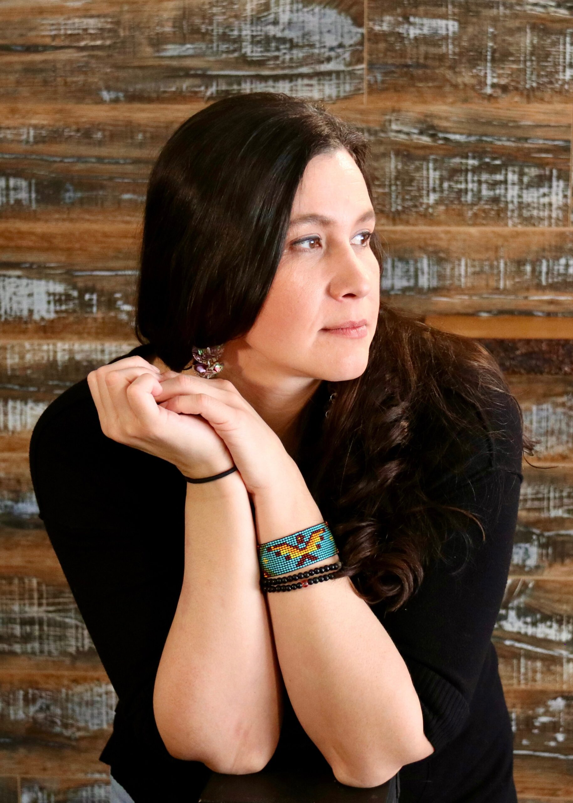 A portrait of the author wearing a beaded bracelet.